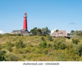 North Tower lighthouse and houses in dunes of Schiermonnikoog, West-Frisian island in Waddensea, Netherlands