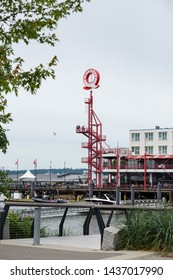 NORTH VANCOUVER, BC, CANADA - JUNE 9, 2019: The boardwalk area near the shipyards at Lonsdale Quay public market.