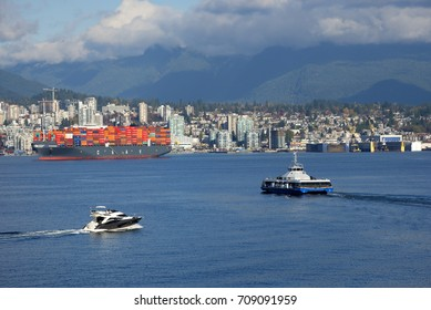 NORTH VANCOUVER - MAR. 11, 2015: The Port of Vancouver, largest in Canada is on the shore of Vanccouver and North Vancouver in Burrard Inlet. Pictured is also SkyTrain ferry connecting North Vancouver