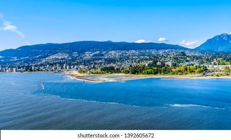 North Vancouver and West Vancouver across Burrard Inlet, the entrance into Vancouver harbor viewed from Prospect Point in Vancouver's Stanley Park