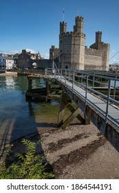 North Wales Caernarfon Castle view from mouth of river Seiont and Menai Straitshowing jetty