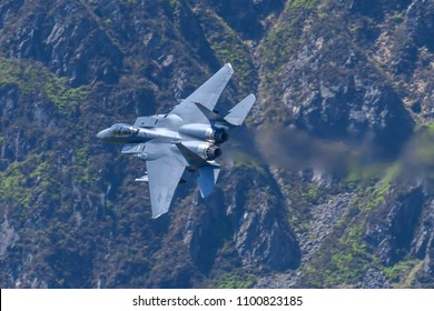North Wales, Great Britain on May 22 2018. USAF F-15E Strike Eagle flying through the Mach Loop