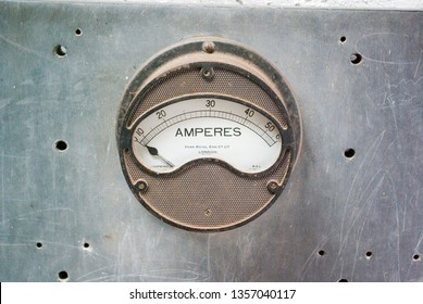 North Wales Snowdon 25 June 2007 Close-up of old fashioned Amperes Meter with silver metal backplate with holes