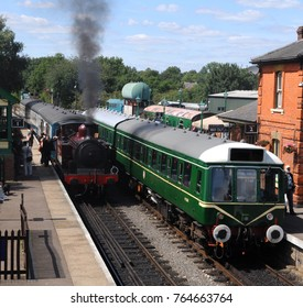 North Weald Station, Epping Ongar Railway, Essex, UK - 08/13/17: 1898 Metropolitan Railway E Class 0-4-4 'Metropolitan Railway No.1' (left) and Class 117 DMU M51384 (right).