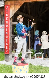 NORTH YORK, CANADA - JULY 01, 2017: A juggler showing his skills at the Black Creek Pioneer Village on the eve of the Canada Day.
