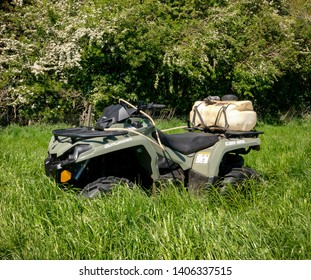 North York Moors, England - May 24th 2019: Can-am Outlander 450 ATV fitted with small sprayer kit for spot weeding