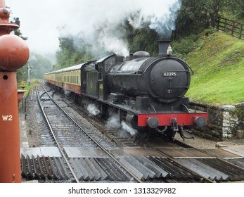 NORTH YORKSHIRE MOORS RAILWAY, NTH YORKSHIRE, UK : 17 SEPTEMBER 2015 : Steam Engine 63395, a T2 Class locomotive pulling coaches into Goathland Station on the North Yorkshire Moors Railway