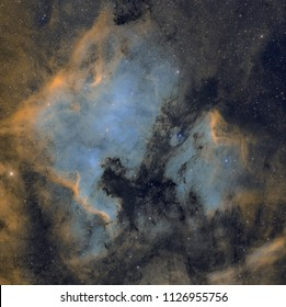Northamerica and pelican nebulas. Real astronomic picture taken with telescope, of 25 hours of combined exposure in narrowband of an emision nebula.