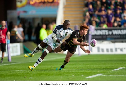 Northampton, UK. 13th October 2018. Andrew Kellaway of Northampton Saints is tackled by Judicael Cancoriet during the European Rugby Challenge Cup game between Northampton Saints and Clermont Auvergne