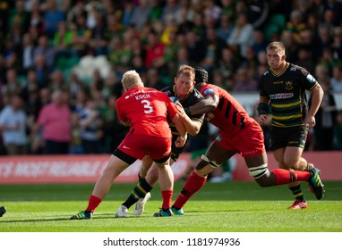 Northampton, UK. 15th September 2018. Dylan Hartley of Northampton Saints is tackled during the Gallagher Premiership round 3 match between Northampton Saints and Saracens at Franklin's Gardens.