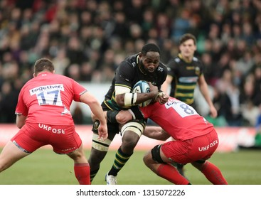 Northampton, UK. 16th February 2019. Api Ratuniyarawa of Northampton Saints is tackled by Josh Beaumont during the Gallagher Premiership Rugby match between Northampton Saints and Sale Sharks
