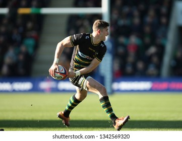 Northampton, UK. 17th March 2019. James Grayson of Northampton Saints passes the ball during the Premiership Rugby Cup Final between Northampton Saints and Saracens