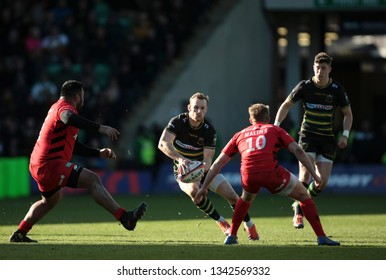 Northampton, UK. 17th March 2019. Rory Hutchinson of Northampton Saints runs with the ball during the Premiership Rugby Cup Final between Northampton Saints and Saracens