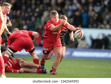 Northampton, UK. 17th March 2019. Richard Barrington of Saracens passes the ball during the Premiership Rugby Cup Final between Northampton Saints and Saracens