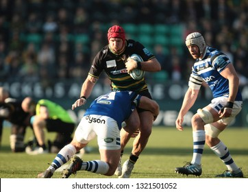 Northampton, UK. 23rd February 2019. James Haskell of Northampton Saints is tackled by Henry Thomas during the Gallagher Premiership Rugby match between Northampton Saints and Bath