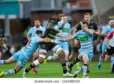 Northampton, UK. 24th August 2018. Courtney Lawes of Northampton Saints is tackled by Ruaridh Jackson during the Pre-Season friendly between Northampton Saints and Glasgow Warriors.