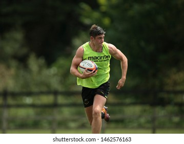 Northampton, UK. 25th July 2019. James Grayson runs with the ball during Northampton Saints Pre-season training ahead of the Gallagher Premiership Rugby 2019-20 Season