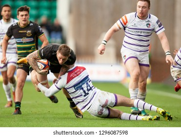 Northampton, UK. 26th January 2019. Teimana Harrison of Northampton Saints is tackled by Leonardo Sarto during the Premiership Rugby Cup match between Northampton Saints and Leicester Tigers