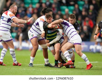 Northampton, UK. 26th January 2019. George Furbank of Northampton Saints is tackled during the Premiership Rugby Cup match between Northampton Saints and Leicester Tigers