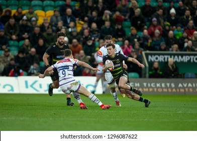 Northampton, UK. 26th January 2019. George Furbank of Northampton Saints runs with the ball during the Premiership Rugby Cup match between Northampton Saints and Leicester Tigers