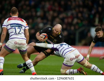 Northampton, UK. 26th January 2019. Ben Franks of Northampton Saints is tackled by Will Evans during the Premiership Rugby Cup match between Northampton Saints and Leicester Tigers