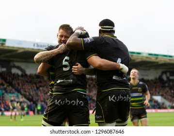 Northampton, UK. 26th January 2019. Teimana Harrison of Northampton Saints celebrates Dominic Barrow's try during the Premiership Rugby Cup match between Northampton Saints and Leicester Tigers