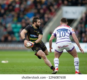 Northampton, UK. 26th January 2019. Cobus Reinach of Northampton Saints runs with the ball during the Premiership Rugby Cup match between Northampton Saints and Leicester Tigers