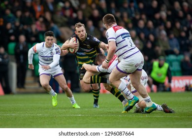 Northampton, UK. 26th January 2019. Rory Hutchinson of Northampton Saints runs with the ball during the Premiership Rugby Cup match between Northampton Saints and Leicester Tigers