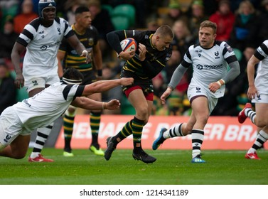 Northampton, UK. 27th October 2018. Ollie Sleightholme of Northampton Saints runs with the ball during the Premiership Rugby Cup match between Northampton Saints and Bristol Bears