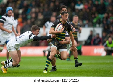 Northampton, UK. 27th October 2018. Alex Mitchell of Northampton Saints runs with the ball during the Premiership Rugby Cup match between Northampton Saints and Bristol Bears