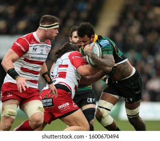 Northampton, UK. 28th December 2019. Courtney Lawes of Northampton Saints is tackled by Gloucester's Josh Hohneck