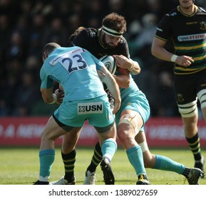 Northampton, UK. 4th May 2019. Tom Wood of Northampton Saints is tackled by Jono Lance during the Gallagher Premiership Rugby match between Northampton Saints and Worcester Warriors
