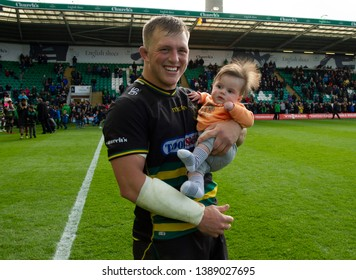 Northampton, UK. 4th May 2019. Alex Waller of Northampton Saints does a lap of honour with his son Beau, after the Gallagher Premiership Rugby match between Northampton Saints and Worcester Warriors