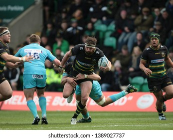 Northampton, UK. 4th May 2019. Tom Wood of Northampton Saints is tackled during the Gallagher Premiership Rugby match between Northampton Saints and Worcester Warriors