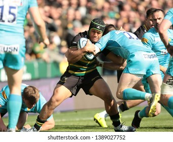 Northampton, UK. 4th May 2019. Samson Ma'asi of Northampton Saints is tackled by Josh Adams during the Gallagher Premiership Rugby match between Northampton Saints and Worcester Warriors