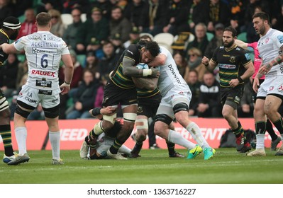 Northampton, UK. 7th April 2019. Courtney Lawes of Northampton Saints is tackled during the Gallagher Premiership Rugby match between Northampton Saints and Gloucester