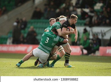 Northampton, UK. 9th February 2019. Rory Hutchinson of Northampton Saints is tackled by David Wilson during the Premiership Rugby Cup semi-final between Northampton Saints and Newcastle Falcons