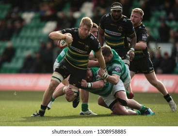 Northampton, UK. 9th February 2019. David Ribbans of Northampton Saints is tackled by David Wilson during the Premiership Rugby Cup semi-final between Northampton Saints and Newcastle Falcons
