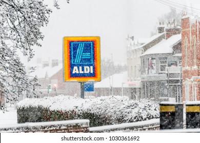 Northampton UK December 10, 2017: Aldi logo sign under heavy winter snow in Northampton town centre