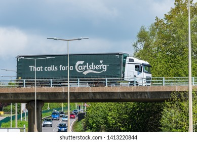 Northampton, UK - May 10th 2019: mercedes carlsberg curtain side truck on uk motorway in motion
