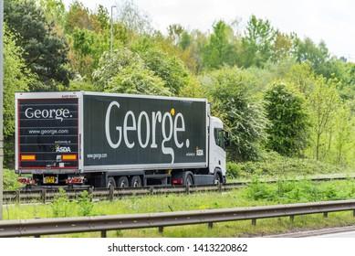 Northampton, UK - May 10th 2019: george asda truck on uk motorway in fast motion