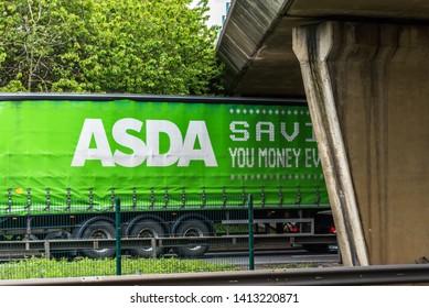 Northampton, UK - May 10th 2019: asda truck on uk motorway in fast motion