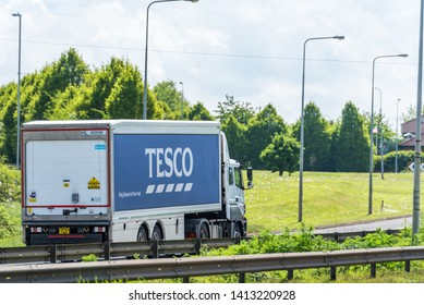 Northampton, UK - May 10th 2019: tesco box truck on uk motorway in fast motion