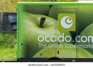 Northampton, UK - May 10th 2019: ocado home delivery van on uk motorway in fast motion