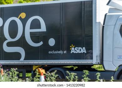 Northampton, UK - May 10th 2019: asda george box truck on uk motorway in fast motion