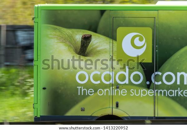Northampton, UK - May 10th 2019: ocado home delivery van on uk motorway in fast motion