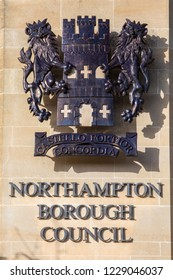 Northampton, UK - November 10th 2018: The crest of Northampton Borough Council on the exterior of Northampton Guildhall in the town of Northampton, UK.
