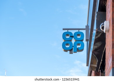 Northampton UK October 28 2018: day view of cooperative logo sign hanging on shop wall