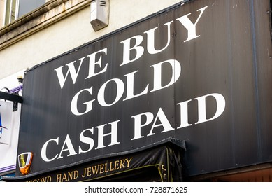 Northampton UK October 5, 2017: We Buy Gold Cash Paod sign in Northampton town centre.