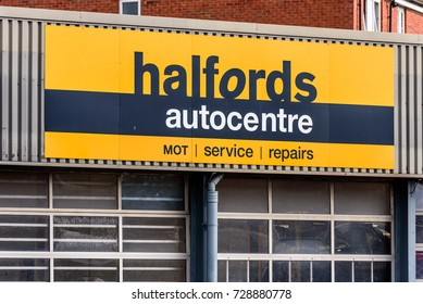Northampton UK October 5, 2017: Halfords Mot and Service Centre logo sign in Northampton town centre.